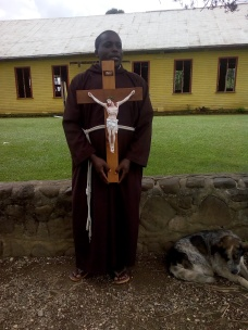 Br. Onesmas stood with a cross before the tribesmen